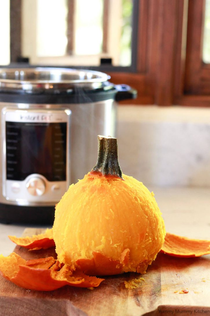 A whole pumpkin is peeled after cooking in the Instant Pot pressure cooker. Instant Pot pumpkin is an easy way to make pumpkin puree.