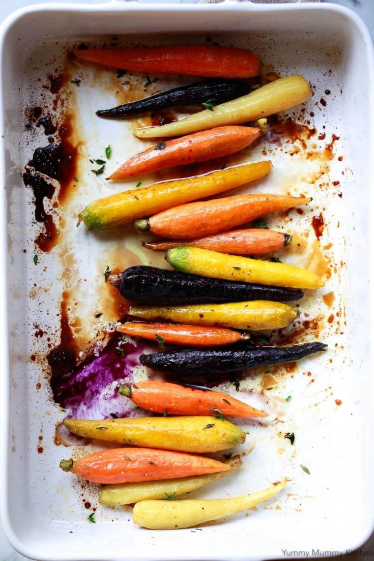 Oven roasted whole carrots are an easy vegetable side dish for the holidays or any day. Maple glazed carrots require just a few ingredients and are beautiful with orange or rainbow carrots.