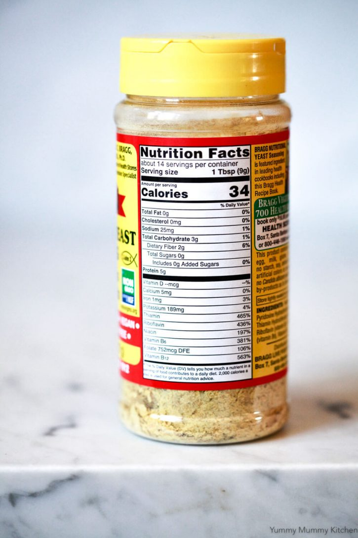 The nutritional information on a container of Bragg's nutritional yeast. Nutritional yeast has benefits for vegetarians and vegans, since it's high in protein and a source of vitamin B-12.
