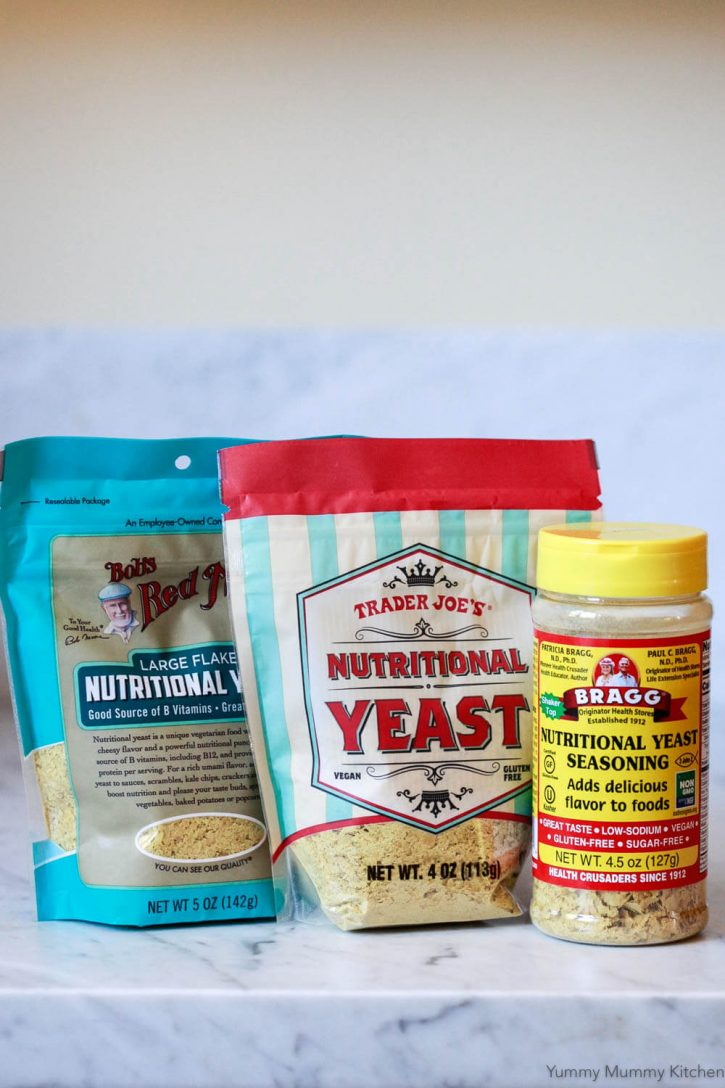 Three brands of nutritional yeast: Bob's Red Mill, Trader Joe's, and Bragg.