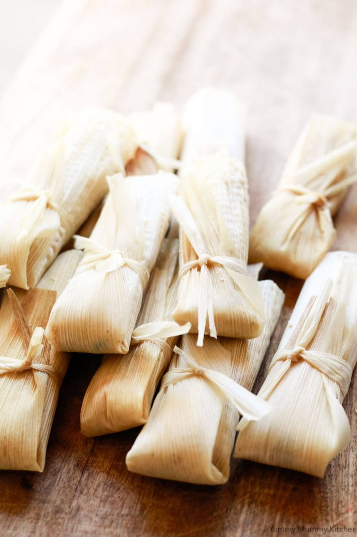 Beautiful vegetarian and vegan tamales are wrapped, tied, and ready to be steamed.