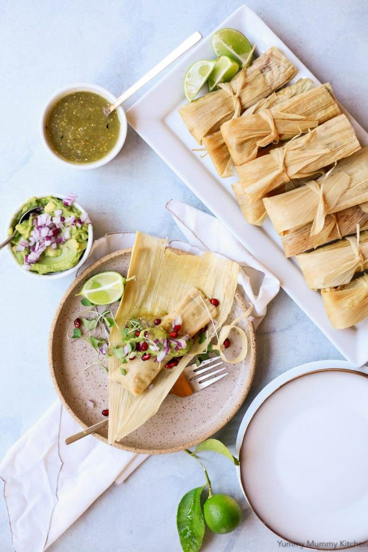 Easy vegetarian or vegan tamales steamed on the stovetop or in the Instant Pot. These gluten-free, vegan tamales are filled with black beans, chilies, and (dairy-free if desired) cheese. Tamales are perfect for a Mexican Christmas dinner.