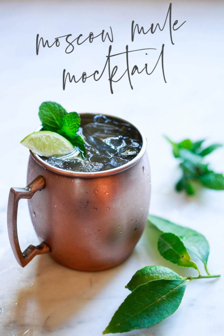 A non alcoholic Moscow mule mocktail recipe in a copper mug garnished with lime and mint. A tasty easy ginger beer mocktail recipe!