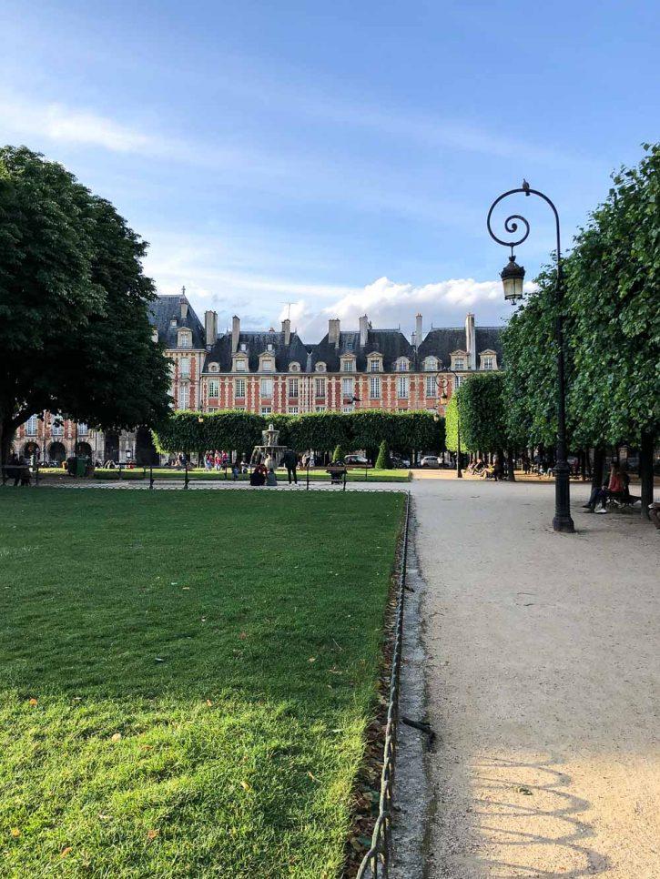 The beautiful Place des Vosges square in le Marais, Paris France.