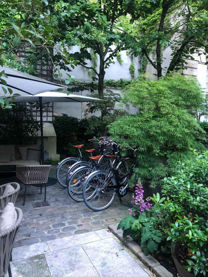 Bicycles in the courtyard of Pavillon de la Reine, Paris.
