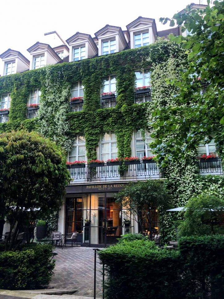 The front of the Pavillon de la Reine hotel in le Marais, Paris France. Pavillon de la Reine review.