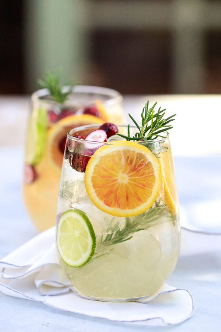 How to make sangria. This recipe for winter white wine sangria with beautiful citrus slices and cranberries is perfect for the holidays. Or swap the citrus for peach to take it into summer.