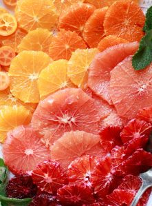 A beautiful citrus fruit salad with oranges, blood oranges, grapefruit, and kumquats.