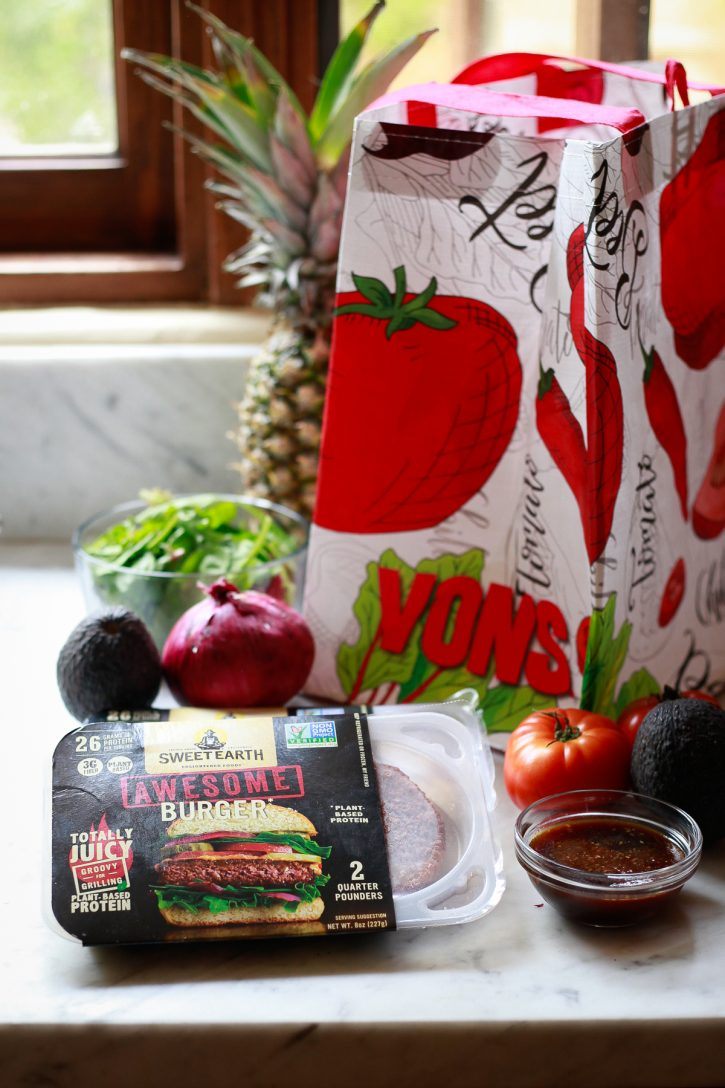 The ingredients for Hawaiian burgers sit on a countertop and include vegan patties from Sweet Earth.