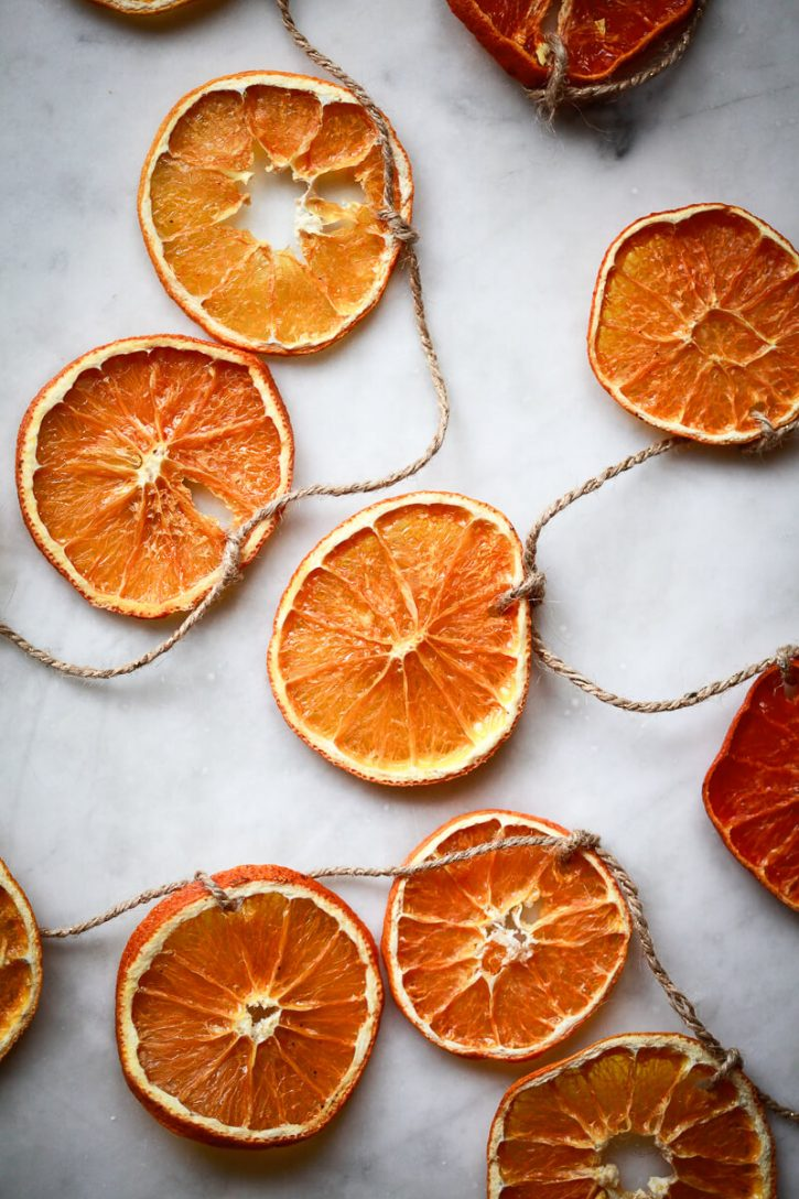 Dried orange slices are strung on twine to make a Christmas garland.