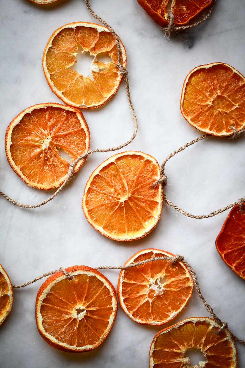 Dried orange slices threaded on a piece of twine to create an orange garland.