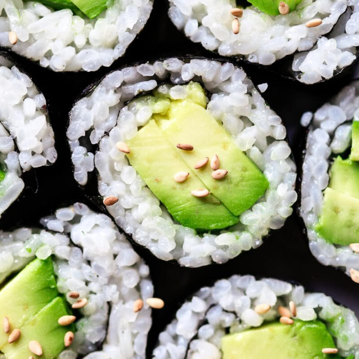 A close up photo of avocado sushi to show of perfect sushi rice made at home in the Instant Pot.