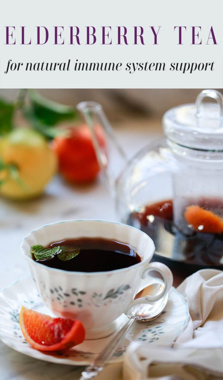 "A cup of elderberry tea next to a teapot. Text overlay reads ""elderberry tea for natural immune system support."""