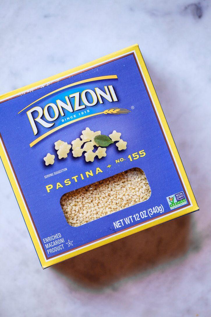 Photo of a box of ronzoni pastina on a kitchen counter.