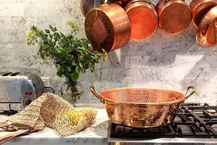A beautiful photo of Mauivel copper pots and pans in a white kitchen. This is one of the safest non toxic cookware choices.