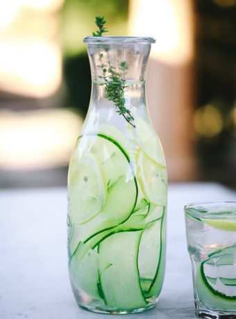 A Weck jar filled with water, cucumber ribbons and lemon slices