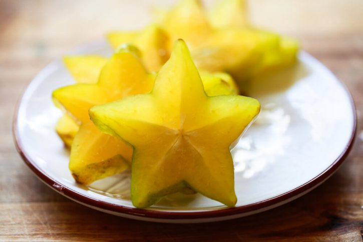 A dish filled with sliced star fruit.