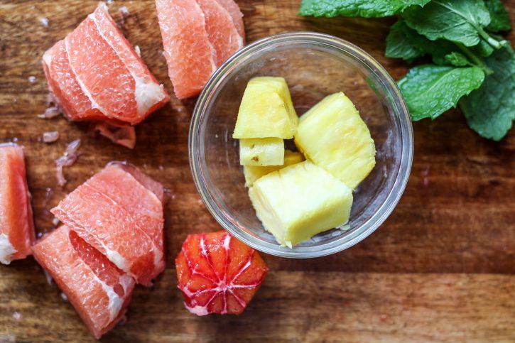 Peeled grapefruit, orange, pineapple and mint.