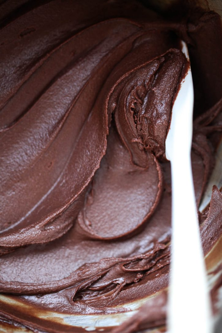 A close-up photo of a homemade dairy-free vegan chocolate frosting.