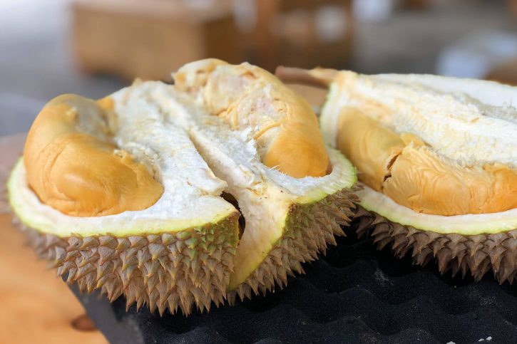 Photograph of halves of durian fruit.