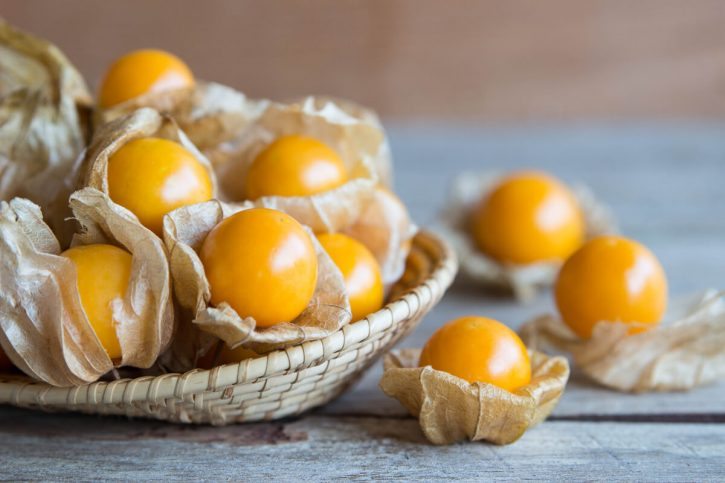 A bowl filled with golden berries.