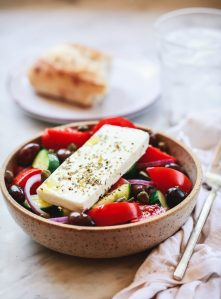 A bowl of authentic traditional Greek salad with feta.