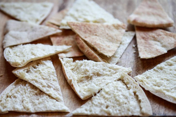 Pita bread triangles are ready to be baked or air fried to make homemade pita chips.