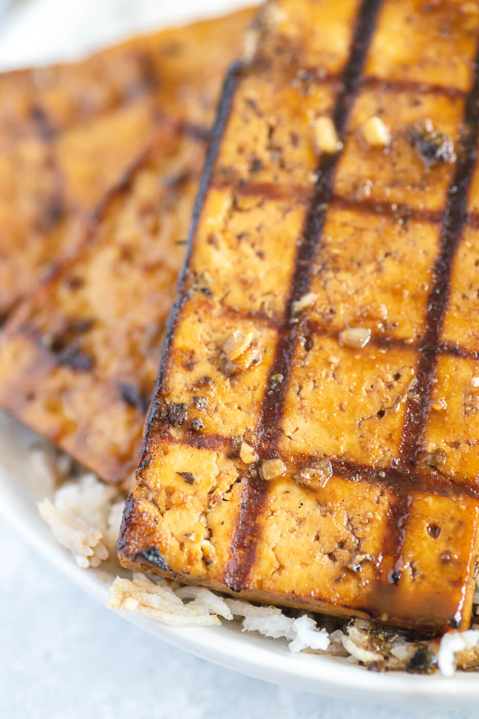 A close-up of grilled tofu steaks.