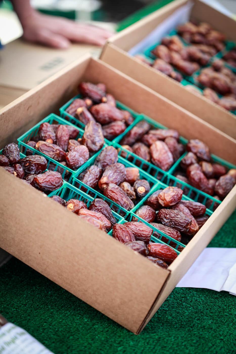 A photo of fresh California Medjool dates sold at a farmers market.