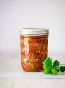 One Ball jar filled with canned salsa.