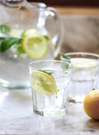 Lemon water on a white kitchen counter.