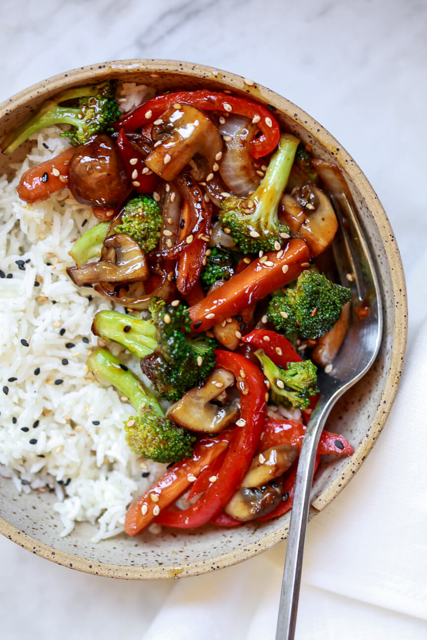 An overhead photo of easy stir fry vegetables that were cooked on a griddle served with rice.