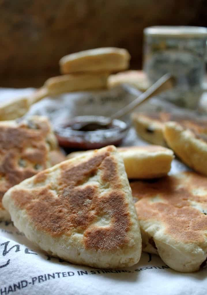 Griddle scones with a bowl of jam in the background.