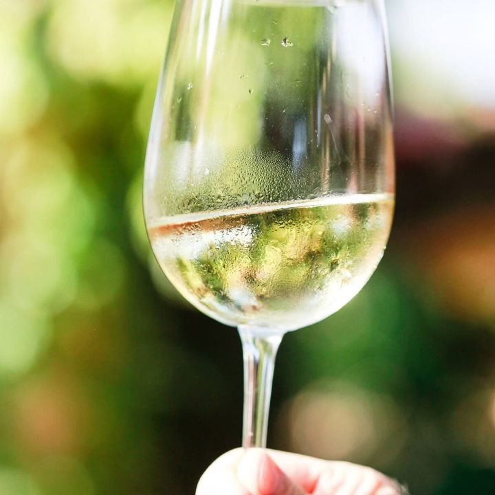 A close-up of a glass of white wine.