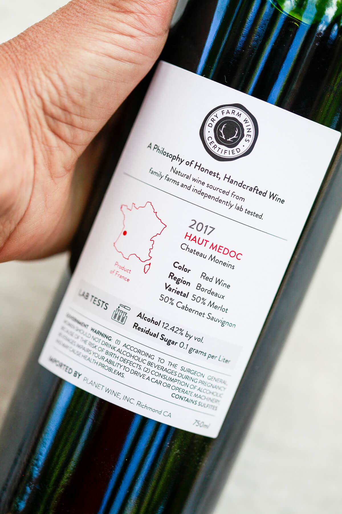 The back of a Dry Farm Wines bottle of read wine. The label shows that this bottle was from 2017 and made in Medoc, France. It also shows the alcohol percentage and residual sugar.