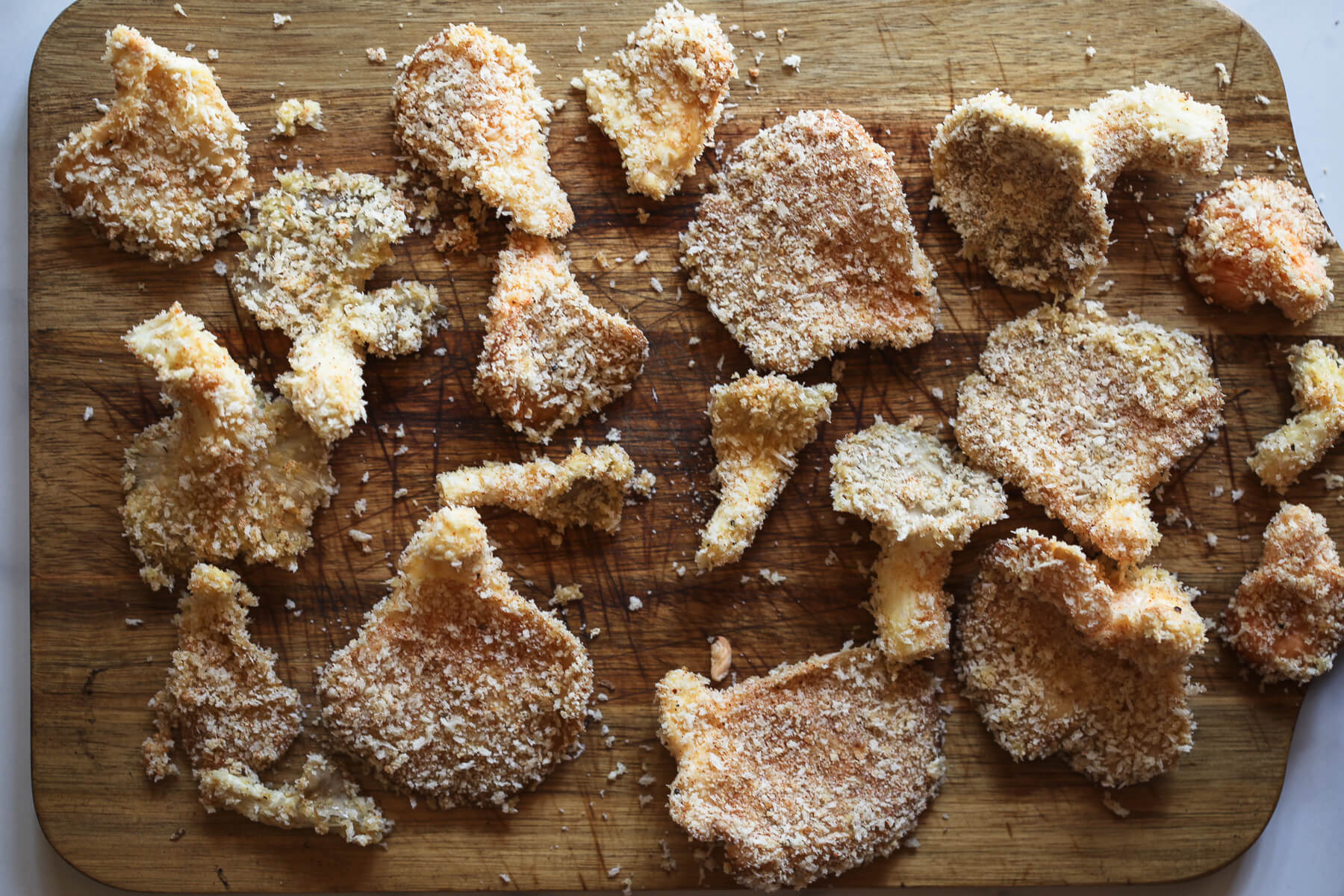 Breaded oyster mushrooms ready to be fried.