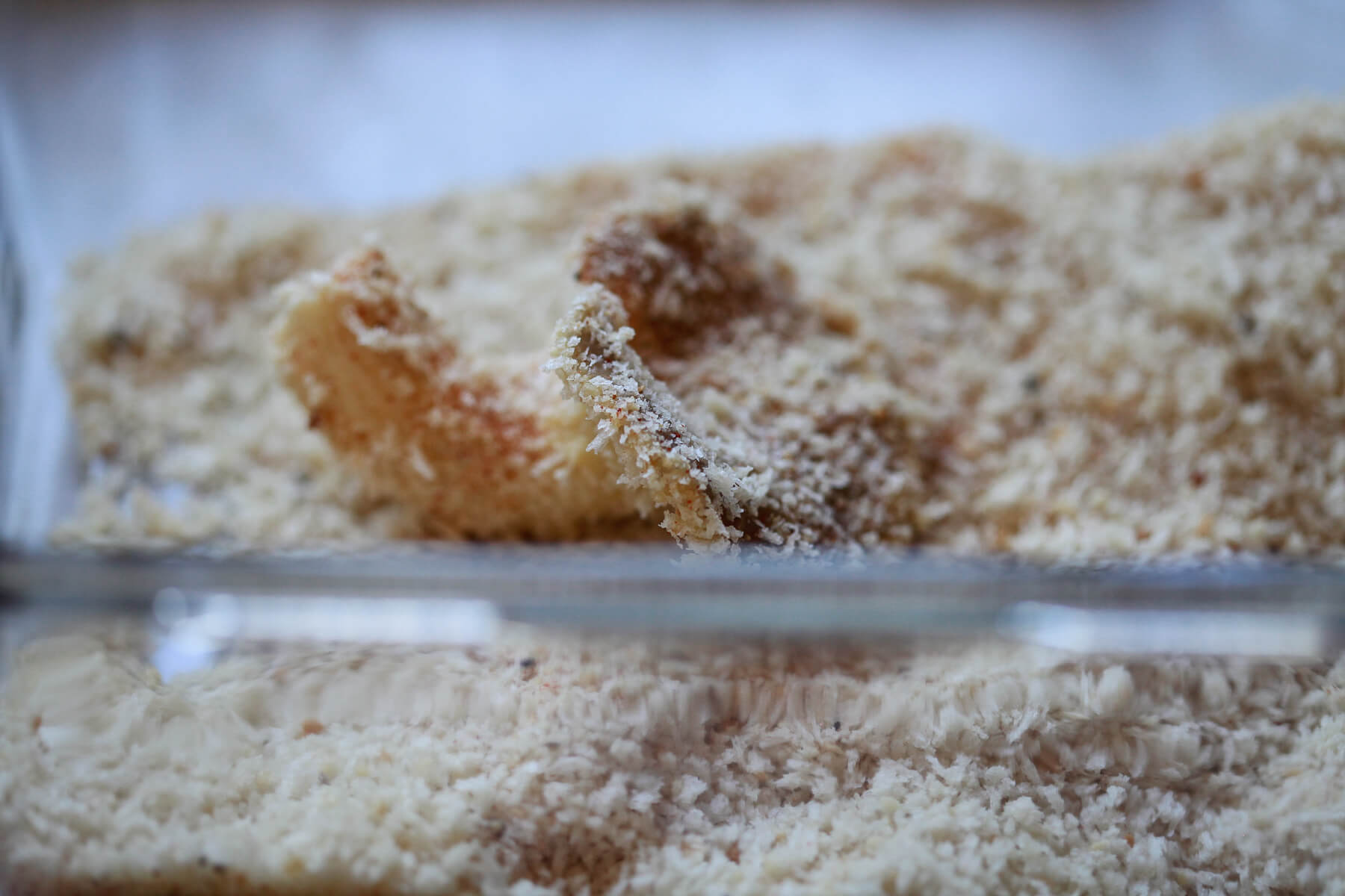 An oyster mushroom is coated in breadcrumbs and spices.