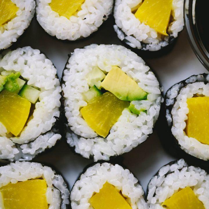 A close-up photo of oshino sushi rolls.