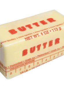 A stick of butter with tablespoons shown on the wrapper.