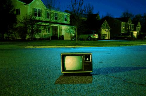 TV set sitting on a street