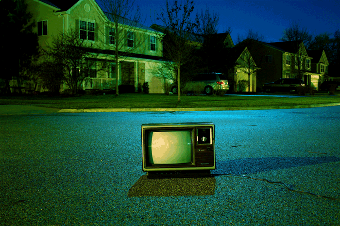 TV set sitting on a street