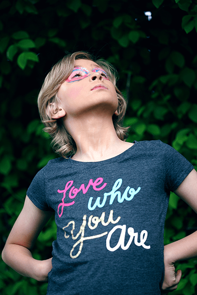 Young person wearing tshirt that says love who you are.