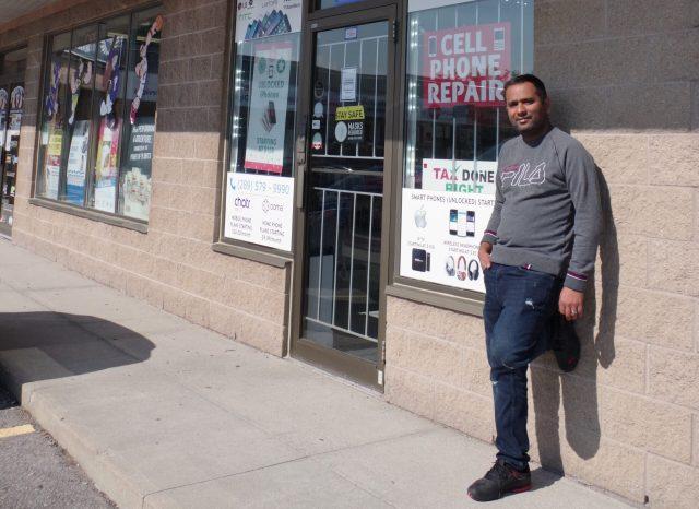 Mubarak in front of his store