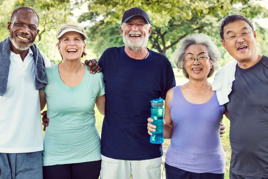 Multiethnic group of older adults outside wearing workout clothes