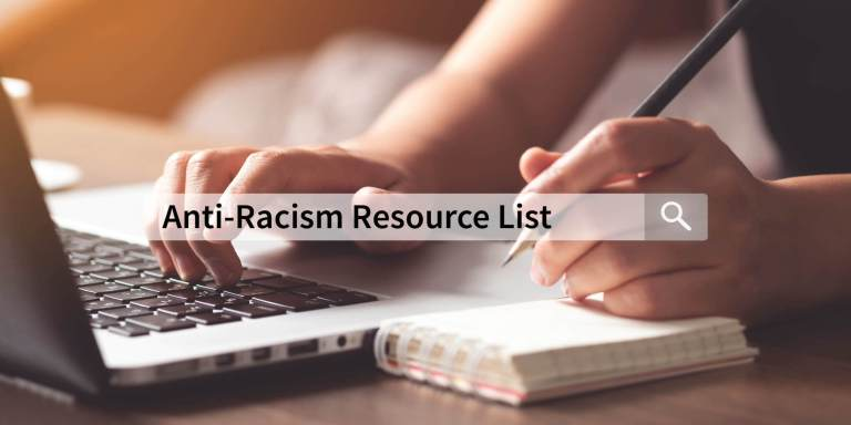 "close up photo of hands typing on a keyboard and posed to take notes in a small notebook. Overlay of a search bar with the words ""Anti-Racism Resource List"" typed inside."