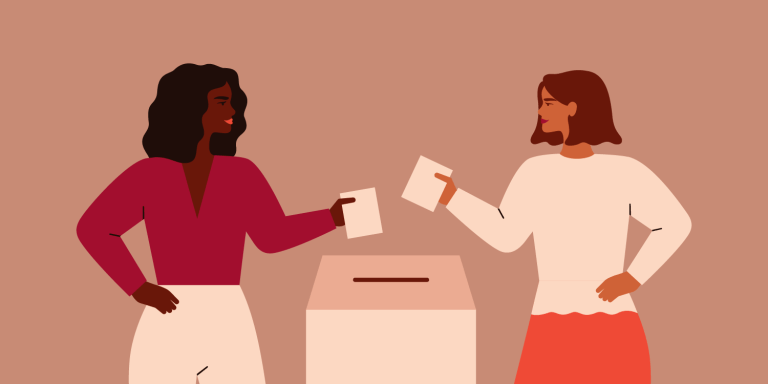 Two Strong girls are putting paper ballot in box