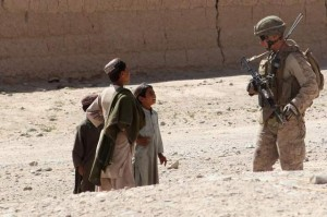 Then-2nd Lt. Kenneth Conover III, 1st platoon commander for Dog Company, 1st Battalion, 7th Marines, speaks to local Afghan children on May 19, 2012. A month later, Conover led a six-day operation in Qaleh-ye Gaz, during which his platoon engaged 'waves of enemy fighters.' (Cpl. Mark Garcia / Marine Corps)