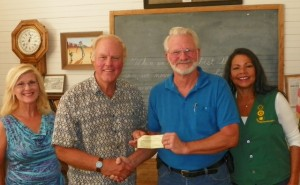 Jim Lincoln, second from left, secretary of the Lamplighter Foundation, presents $2,500 in matching funds to Twentynine Palms Historical Society President, Les Snodgrass. The money matches proceeds from the society's Desert Chic Wine & Cheese Social, coordinated by Cathy Snodgrass, far left, and Laureen Lentz.