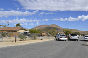The suspect in an early morning homicide in the Home Depot parking lot in Yucca Valley was found hiding behind this home in the 6400 block of Goleta Ave. and taken into custody.