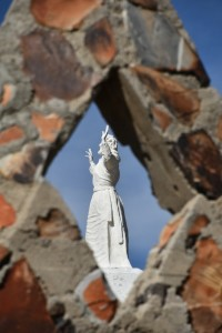 A statue of Jesus can be seen through the diamond cut-out of the Rock Chapel.